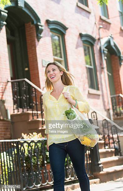 USA, New Jersey, Jersey City, Woman walking in street