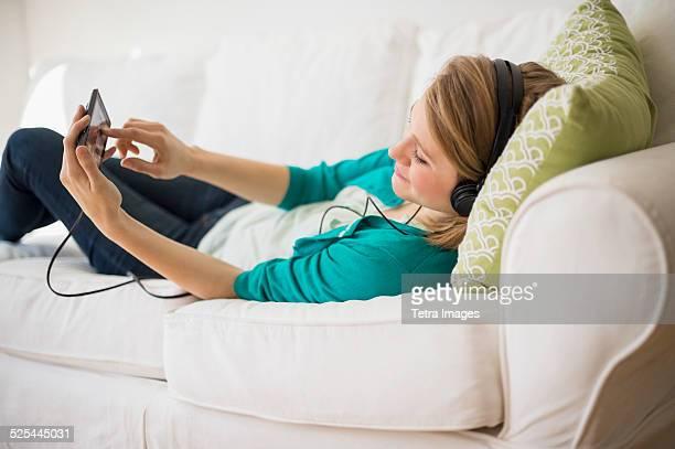 USA, New Jersey, Jersey City, Woman watching movie on smart phone