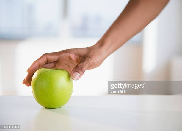 USA, New Jersey, Jersey City, Woman's hand reaching for apple