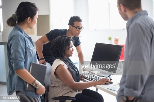 USA, New Jersey, Jersey City, Women and men working in office
