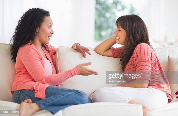 USA, New Jersey, Jersey City, Women chatting on sofa