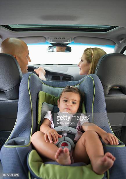 USA, New Jersey, Jersey City, Young family with small girl (12-18 months) sitting in car