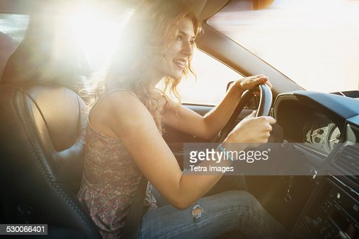 USA, New Jersey, Jersey City, Young woman driving car