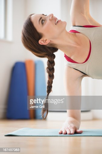 USA, New Jersey, Jersey City, Young woman exercising at home : Stock Photo