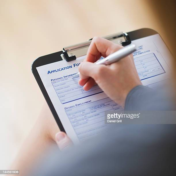 USA, New Jersey, Jersey City, young woman filling application form