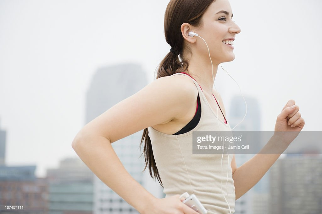 USA, New Jersey, Jersey City, Young woman jogging : Stock Photo