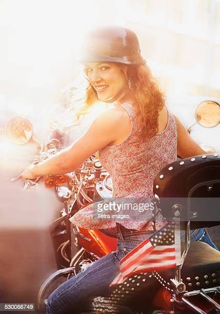 USA, New Jersey, Jersey City, Young woman riding motorcycle