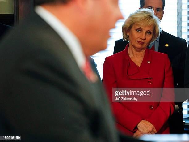 New Jersey Lt Gov Kim Guadagno looks on as New Jersey Gov Chris Christie outlines plans for a special election to be held to fill the vacant US...