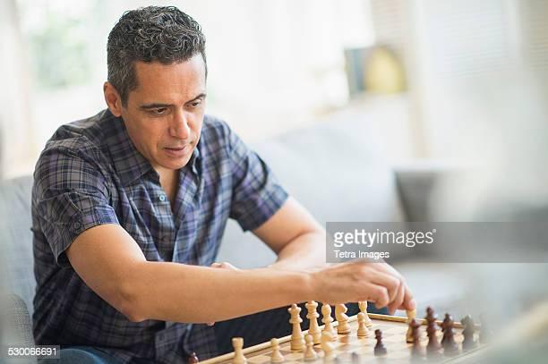 USA, New Jersey, Mature man playing chess