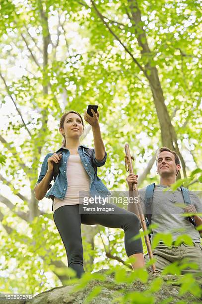 USA, New Jersey, Mendham, Couple hiking with GPS in forest