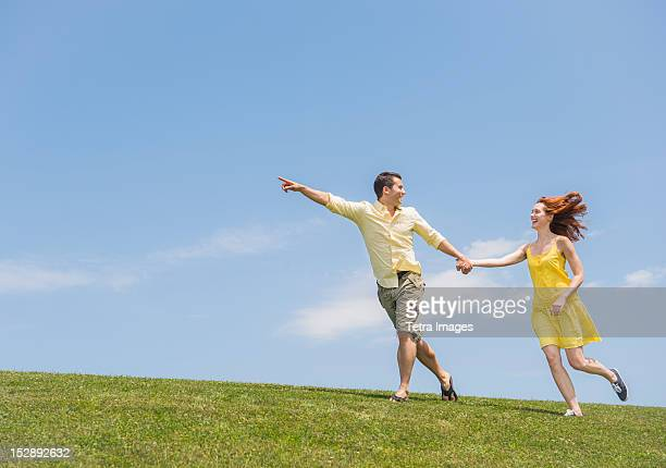 USA, New Jersey, Mendham, Couple running on meadow