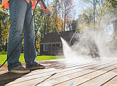 USA, New Jersey, Mendham, Man cleaning porch