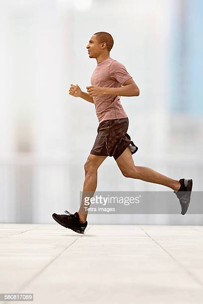 USA, New Jersey, Mid adult man running