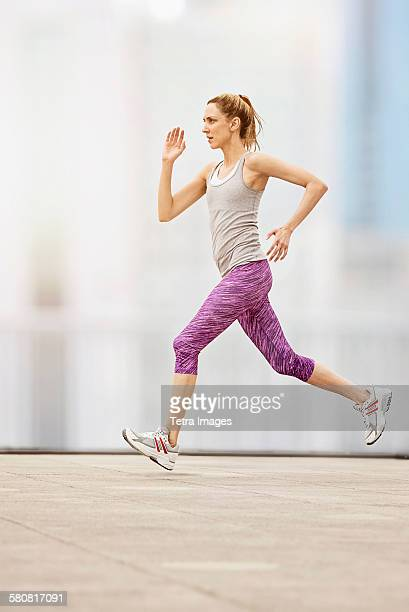 USA, New Jersey, Mid adult woman running