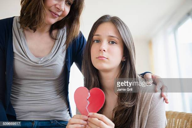 USA, New Jersey, Mom comforting her heartbroken teenage daughter (14-15)