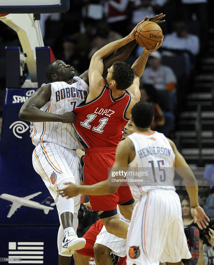 New Jersey Nets' Brook Lopez (11) gets fouled by Charlotte Bobcats' DeSagana Diop (7) while going to the basket during the first half of their game at Time Warner Cable Arena on March 4, 2012, in Charlotte, North Carolina.