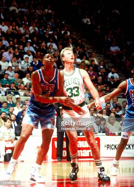 New Jersey Nets forward Derrick Coleman left jockeys for position against Boston Celtic forward Larry Bird right during a game in Hartford...