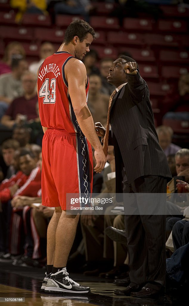 New Jersey Nets head coach Avery Johnson, right, makes a point to Kris Humphries after being replaced in the first quarter at Arco Arena in Sacramento, California, on Friday, November 19, 2010.