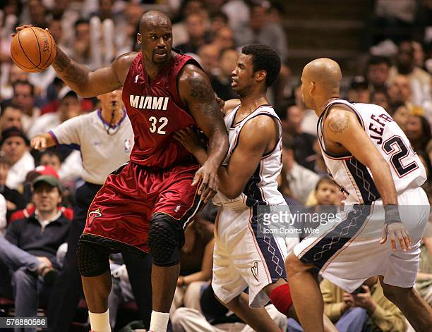 New Jersey Nets Jason Collins and Richard Jefferson guard Miami's Shaquille O'Neal in the first half of game 3 round 1 of the NBA Playoffs in East...