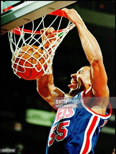 New Jersey Nets' Jayson Williams dunks for two points in the first quarter 21 November at the Palace in Auburn Hills Michigan Williams led all...