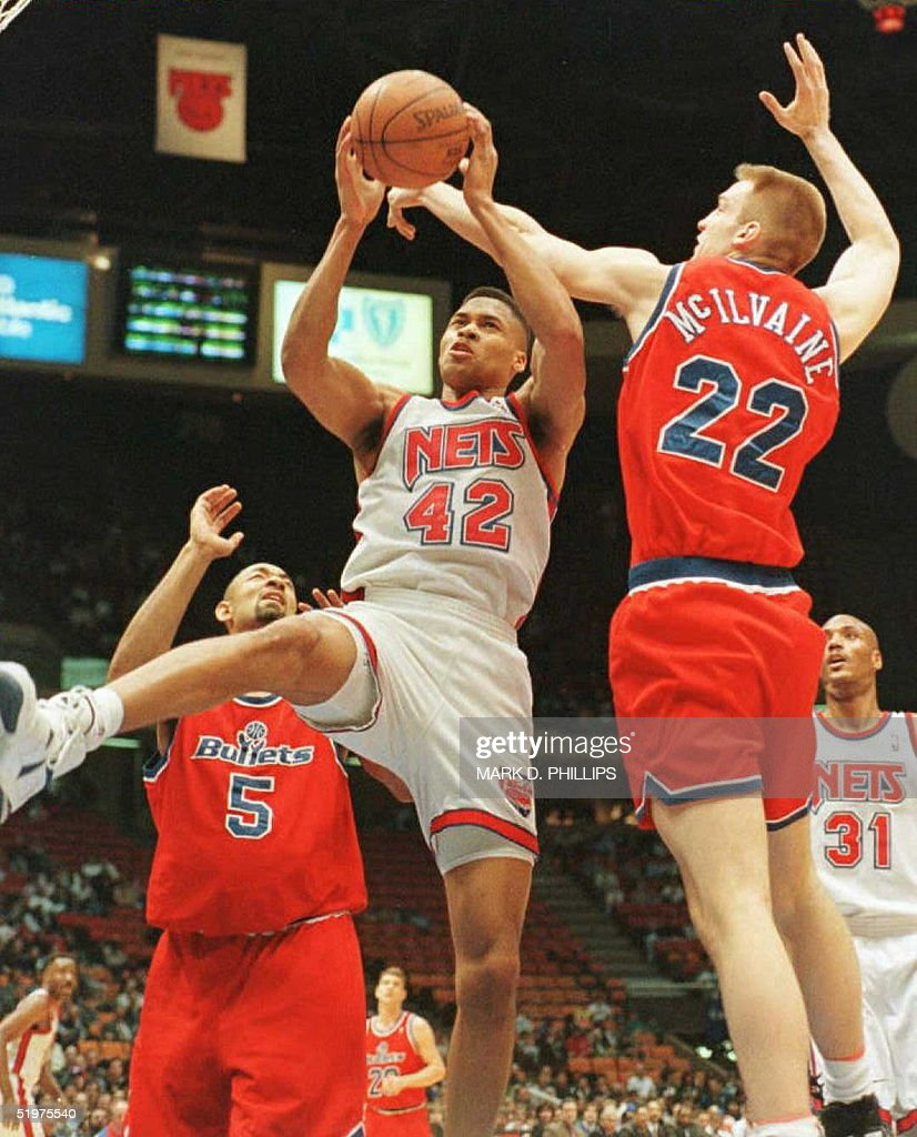 New Jersey Nets P J Brown 42 grabs a rebound be