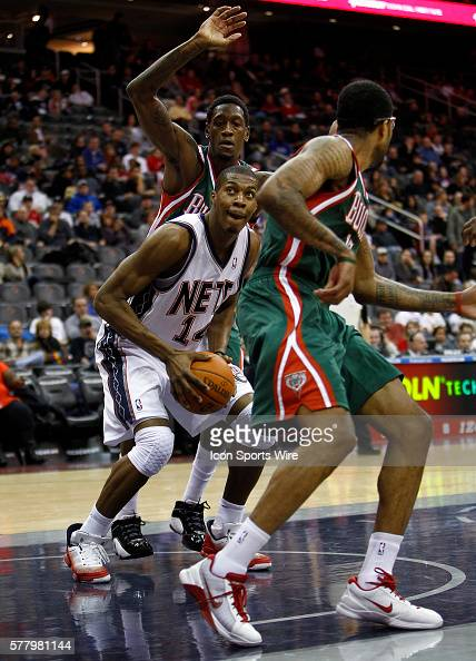 New Jersey Nets power forward Derrick Favors drives through Milwaukee Bucks power forward Larry Sanders at the Prudential Center in January 8 2011 in...