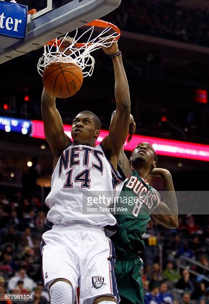 New Jersey Nets power forward Derrick Favors dunks in front of Milwaukee Bucks power forward Larry Sanders at the Prudential Center in January 8 2011...