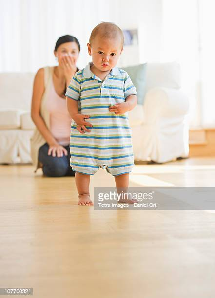 USA, New Jersey, New Jersey City, Mother watching her son's first steps (6-11 months)