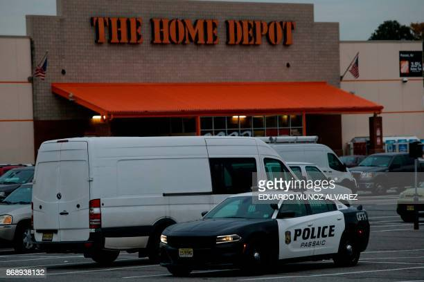 New Jersey police car stands guard at the Home Depot store where suspect Sayfullo Saipov rented the truck on November 1 in Passaic New Jersey A...