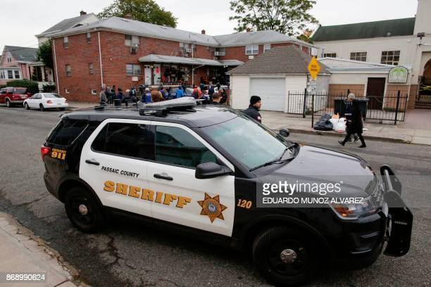 New Jersey police car stands guard in front of the unit where suspect Sayfullo Saipov lived on November 1 in Paterson New Jersey A pickup driver...