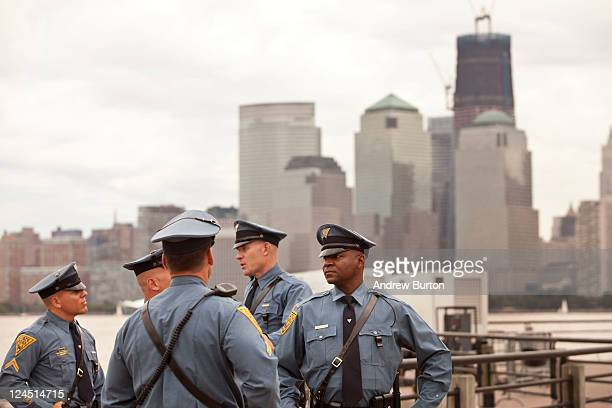 New Jersey police officers wait for the memorial dedication to Empty Sky Memorial to start at Liberty State Park on September 10 2011 in Jersey City...