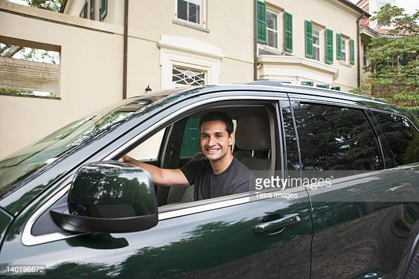 USA, New Jersey, Portrait of man driving car