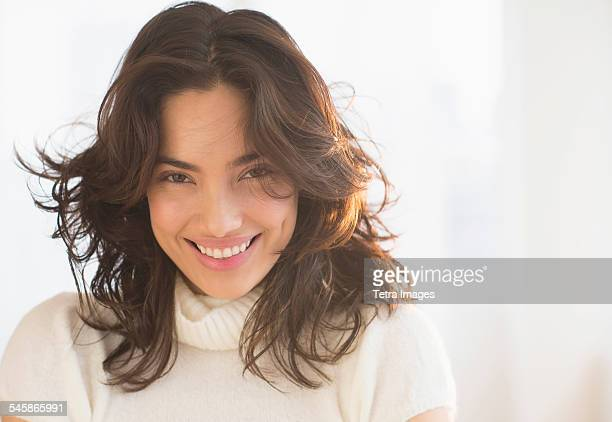 USA, New Jersey, Portrait of smiling young woman