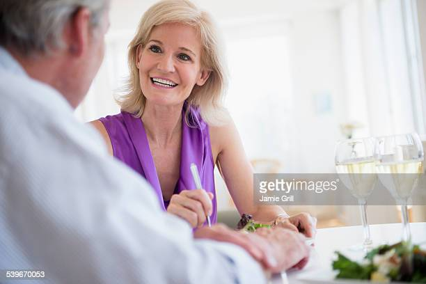 USA, New Jersey, Portrait of woman talking to man at restaurant table