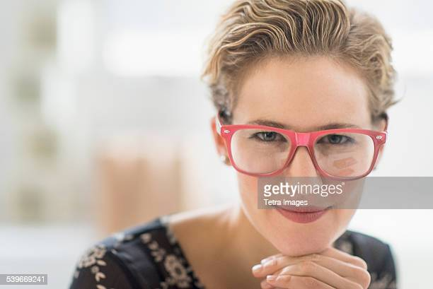 USA, New Jersey, Portrait of young woman wearing glasses