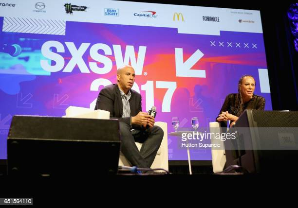 New Jersey Senator and former Newark Mayor Cory Booker and Google's Senior Counsel on Civil and Human Rights Malika Saada Saar speak onstage at the...