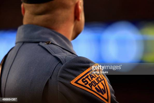 New Jersey State Police trooper looks on during Super Bowl XLVIII between the Seattle Seahawks and the Denver Broncos at MetLife Stadium on February...