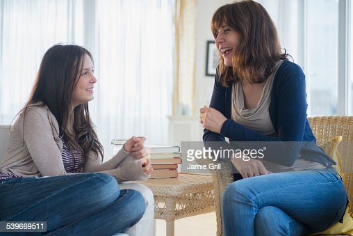 USA, New Jersey, Teenage girl (14-15) talking with her mom in living room