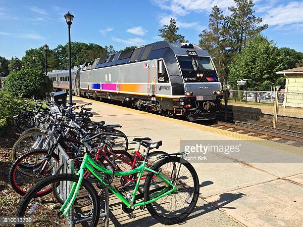 New Jersey Transit train arrives at station with bicycles