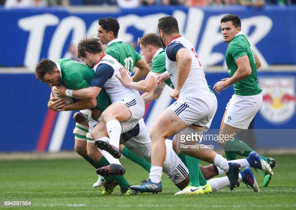 New Jersey United States 10 June 2017 Jack Conan of Ireland is tackled by AJ MacGinty of USA during the international match between Ireland and USA...