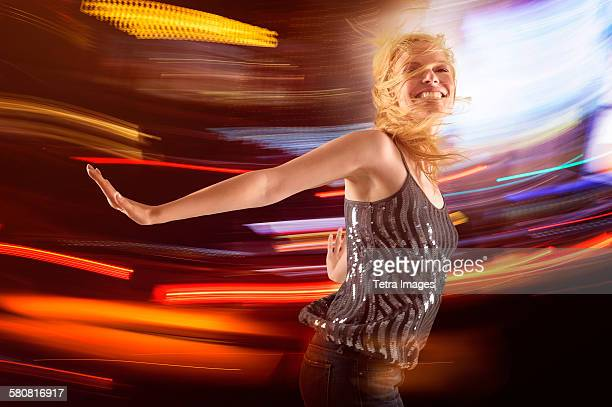 USA, New Jersey, Woman dancing in club