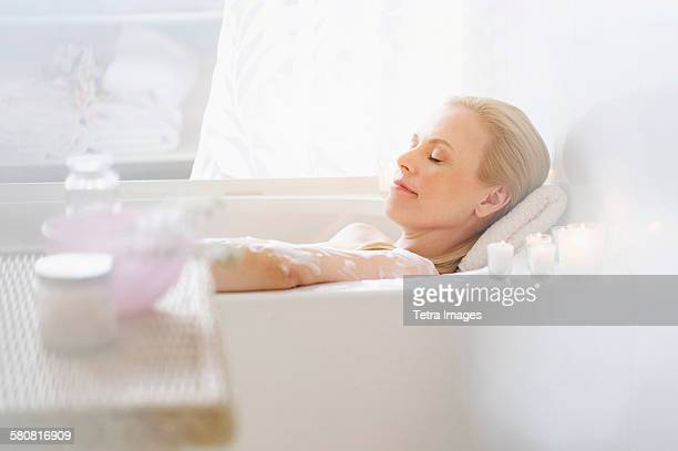 USA, New Jersey, Woman relaxing in bath