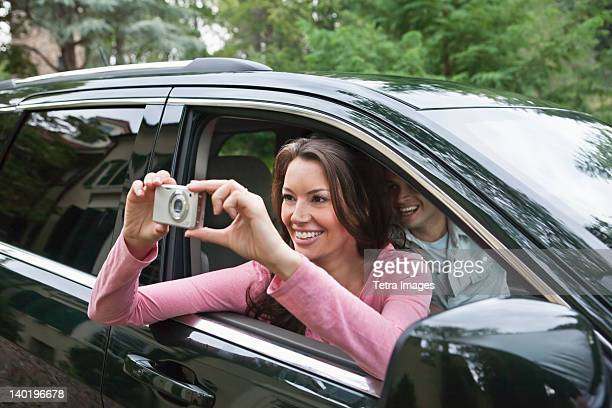USA, New Jersey, Woman taking pictures from car