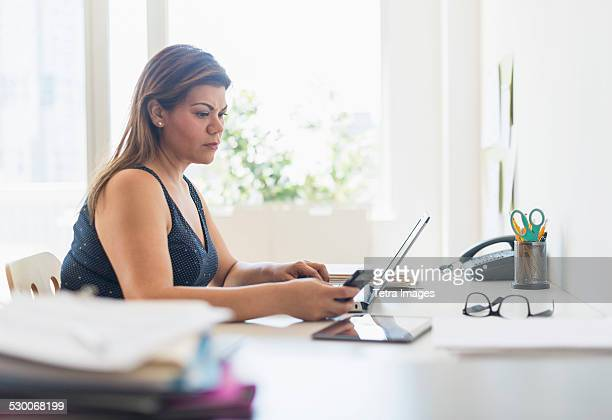 USA, New Jersey, Woman working in home office
