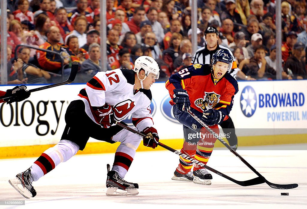New Jersey's Alexei Ponikarovsky beats Florida's Brian Campbell to the puck at center ice during Game 2 of the NHL Eastern Conference quarterfinals on Sunday, April 15, 2012, in Sunrise, Florida. The Panthers defeated the Devils, 3-2.
