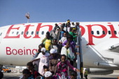 New Jewish immigrants walking down the airplane during a welcoming ceremony after arriving on a flight from Ethiopia on August 28 2013 at Ben Gurion...