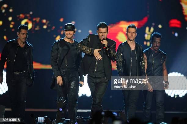 New Kids on the Block members Jonathan Knight Donnie Wahlberg Jordan Knight Joey McIntyre and Danny Wood perform at Xcel Energy Center on June 14...