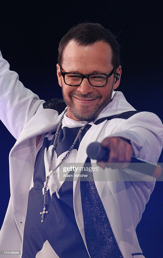 New Kids On The Block singer <a gi-track='captionPersonalityLinkClicked' href=/galleries/search?phrase=Donnie+Wahlberg&family=editorial&specificpeople=220537 ng-click='$event.stopPropagation()'>Donnie Wahlberg</a> performs during 'The Package Tour' with 98 Degrees And Boyz II Men at Target Center on July 20, 2013 in Minneapolis, Minnesota.
