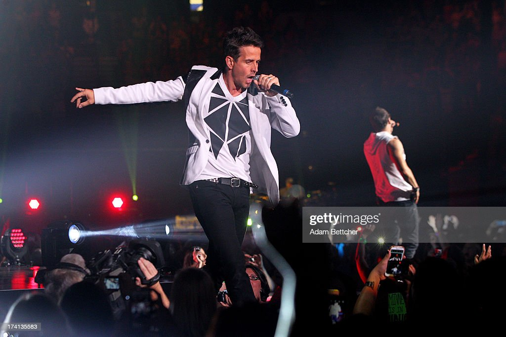 New Kids On The Block singer Joey McIntyre performs during 'The Package Tour' with 98 Degrees And Boyz II Men at Target Center on July 20, 2013 in Minneapolis, Minnesota.