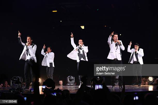 New Kids On The Block singers Donnie Wahlberg Joey McIntyre Danny Wood Jordan Knight and Jonathan Knight perform during 'The Package Tour' with 98...